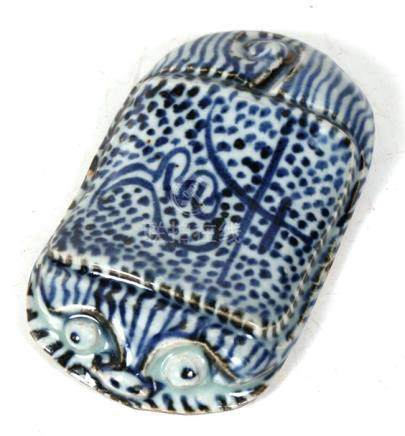 A Chinese blue & white wrist rest (possibly 18th / 19th century) in the form of a stylised tiger,