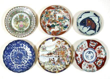 A Chinese famille rose plate; together with a group of Japanese plates including Imari (6).