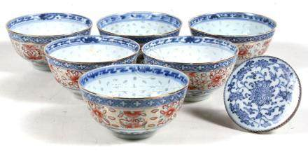 A Chinese silver mounted blue & white plaque decorated with flowers; together with a set of six