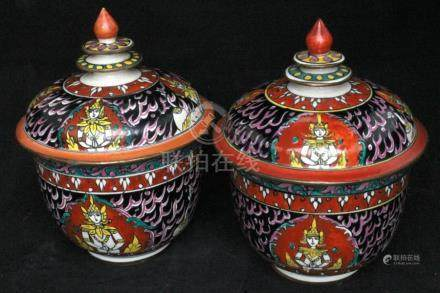A pair of Thai Bencharong bowls & covers, decorated with figures on a black ground, 16cms (6.