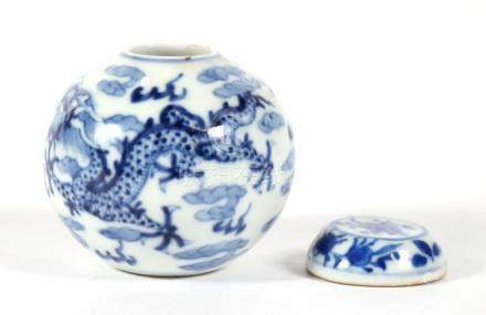 A Chinese blue & white miniature ginger jar decorated with dragons amongst clouds chasing pearls,
