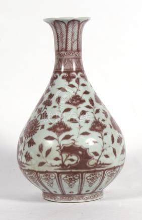 A Chinese Ming style vase decorated with flowers and foliage, 33cms (13ins) high.