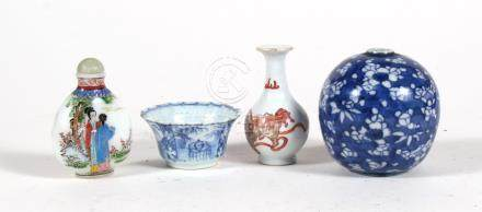 A Chinese blue & white tea bowl; together with a Chinese prunus vase of globular form, 8cms (3.1ins)