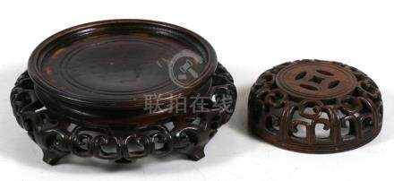 A Chinese pierced hardwood vase stand, 14cms (5.5ins) diameter; together with a pierced hardwood