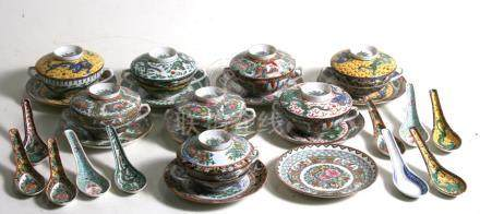 A set of eight assorted pattern Chinese famille rose twin-handled soup cups on stands, with matching