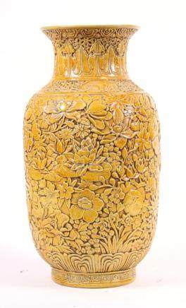A Chinese yellow ground vase with all over relief foliate decoration, impressed seal mark to