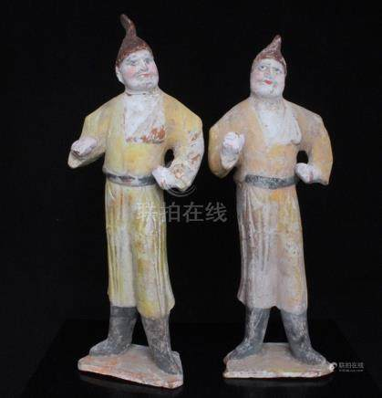 A pair of Chinese polychrome terracotta foreigner figures, the largest 31cms (12.25ins) high (2).