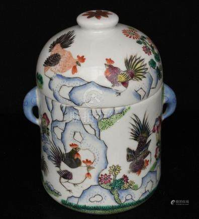 A Chinese famille rose pot and cover decorated with chickens amongst rocks, red seal mark to
