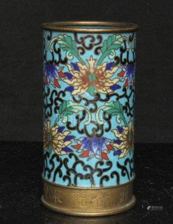 A Chinese cloisonne brush pot decorated with flowers on a turquoise ground, with calligraphy