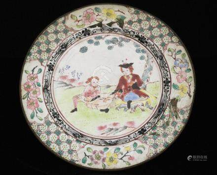 An 18th century Chinese enamel dish decorated with European figures within a foliate border,