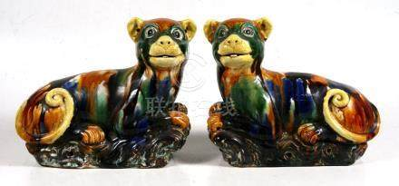 A pair of Chinese sancai glazed models of recumbent dogs, purported to be from Little Sodbury Manor,