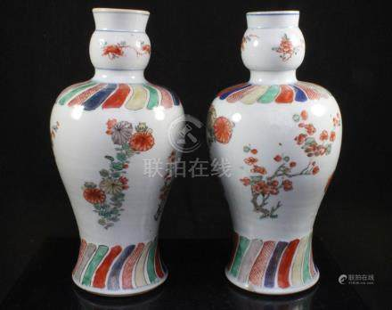 A pair of Chinese Kangxi famille rose vases decorated with flowers, 24cms (9.5ins) high.Condition
