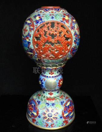 A Chinese famille verte reticulated hat stand on stand with blue four-character seal mark to