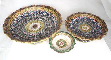 Three Chinese 19th century Bencharong tazza's the largest 27cms (10.5ins) diameter.