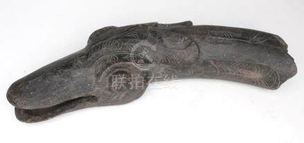 A Han dynasty style grey pottery fragment in the form of a goose's head, 25cms (10ins) wide.