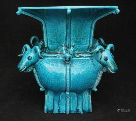 A Chinese archaic style turquoise glazed square form vase, with four rams to the corners, square