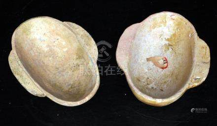 A pair of Chinese glazed ear cups, probably Han dynasty, 10.5cms (4.1ins) wide.