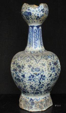 An early Persian style blue & white garlic neck vase decorated with figures and flowers, 33cms (