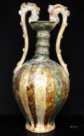 A Chinese sancai glazed vase with twin dragon form handles, 35cms (13.75ins) high.