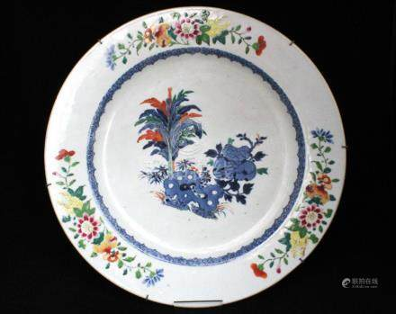 A Chinese Doucai charger decorated with flowers (restored), 39cms (15.25ins) diameter.