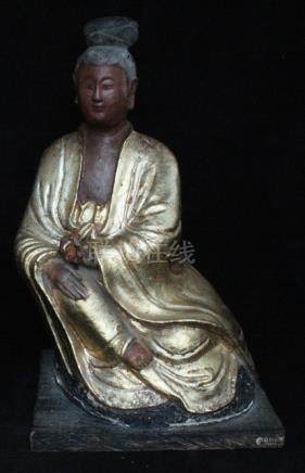 A Chinese gilded seated robed figure, 36cms (14ins) high.