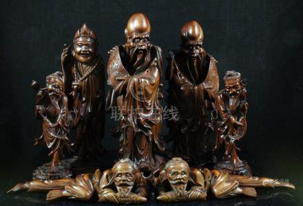 A group of Chinese rootwood figures, the largest 19cms (7.5ins) high (7).