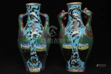A pair of 19th century Chinese two-handled vases decorated with dragons and flowers on a turquoise
