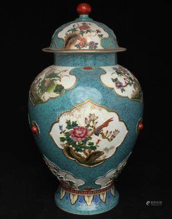 A Chinese baluster vase & cover decorated with relief moulded panels depicting birds, insects and