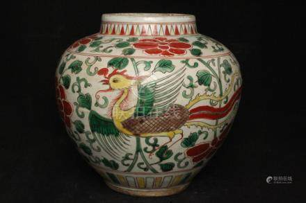 A Chinese Wucai vase decorated with phoenix and flowers, 21cms (8.25ins) high.