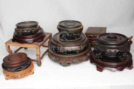 A quantity of Chinese hardwood vase stands (13).