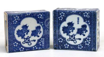 A pair of Chinese blue & white flower bricks or pillows, decorated with fo dogs & prunus, 14cms (5.