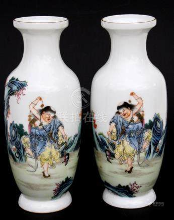 A pair of Chinese Republic vases decorated with a figure in a landscape, four character mark to