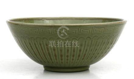 A Chinese celadon glazed bowl decorated with foliate scrolls, 29cms (11.5ins) diameter.