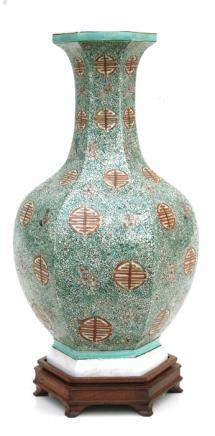 A Chinese hexagonal form vase decorated with blossom and foliate scrolls, on a hardwood stand, 38cms