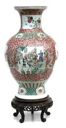 A large Chinese famille rose baluster vase on stand, decorated with figures, birds and flowers