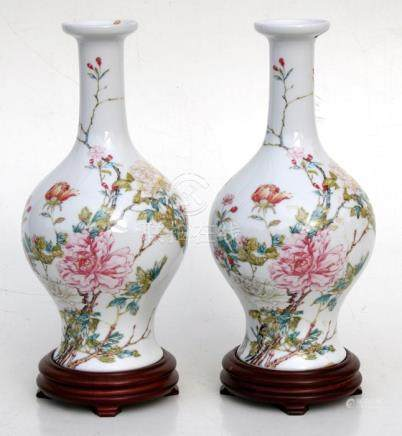 A pair of Chinese Republic style vases on stands, decorated with flowers, 27cm (10.5ins) high.