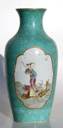 A Chinese famille rose vase decorated with figure within panels on a turquoise ground, red seal mark