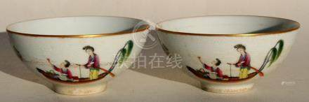 A pair of Chinese Qing dynasty tea bowls decorated with figures in boats on a sgraffito decorated