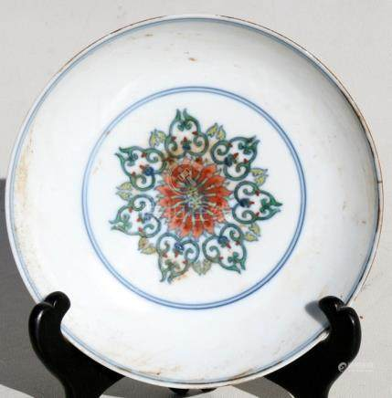 A small Chinese Doucai shallow footed dish with blue seal mark to underside, 15.5cms (6ins)