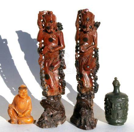A Chinese amber coloured soapstone carving in the form of a robed figure holding a sceptre, 7cms (