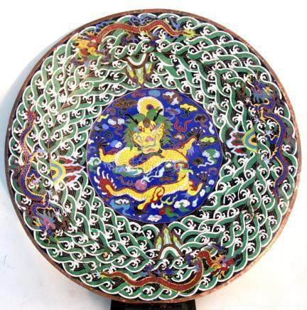 A large Chinese cloisonne charger with central yellow dragon chasing a flaming pearl within a wave