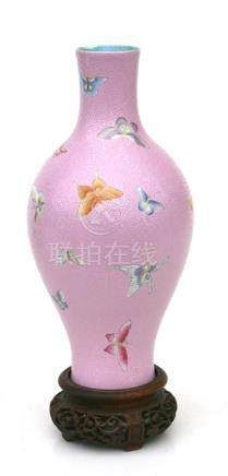 A Chinese vase decorated with butterflies on a pink sgraffito decorated ground, red seal mark to