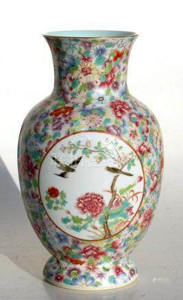 A Chinese millefiori vase decorated with birds and flowers within panels, red seal mark to