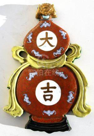 A Chinese ceramic wall plaque in the form of a double gourd vase decorated with bats and calligraphy