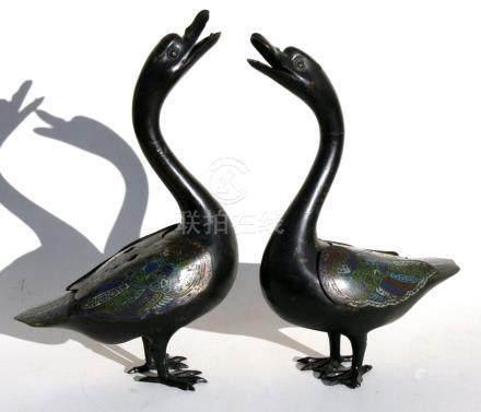 A pair of Chinese bronze & enamel censers in the form of geese, 39cms (15.25ins) high (2).