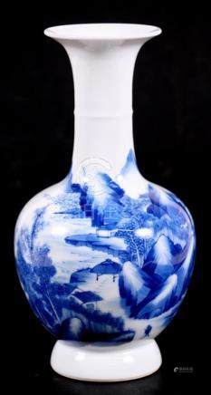 A Chinese blue & white vase decorated with figures in a mountainous landscape, 21cms (8.25ins)