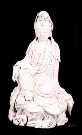 A Chinese blanc de chine style figure depicting Guanyin, 31cms (12.25ins) high.
