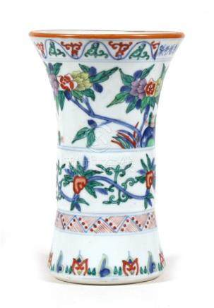 A Chinese vase decorated birds, flowers and foliage. 24cm (9.5 ins) high