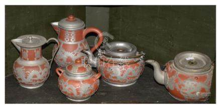 Five Chinese pewter clad Yixing pieces comprising: two teapots, two hot water jugs and a lidded