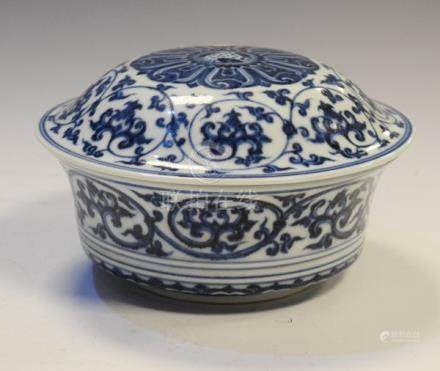 Chinese porcelain circular bowl and cover having blue and white foliate scroll decoration, the